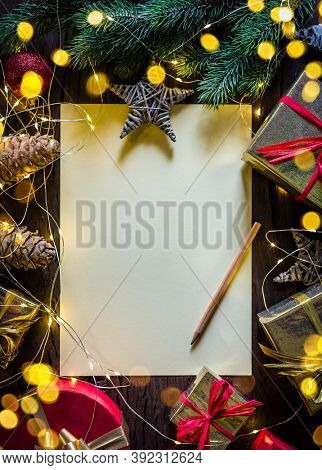 Empty Santa paper letter and christmas decoration around it. Christmas or New Year holiday background.