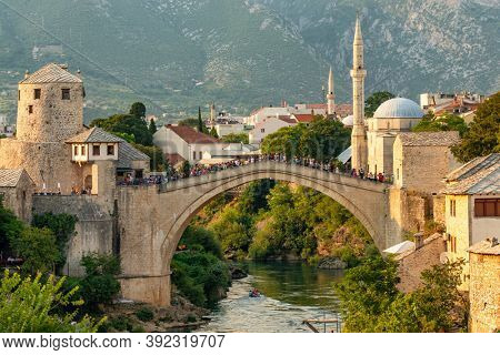 Mostar, BiH - August 30, 2019: Stari Most bridge at sunset in old town of Mostar, Bosnia and Herzegovina