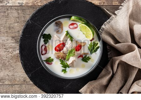 Traditional Thai Food Tom Kha Gai And Ingredients On Wooden Table. Top View