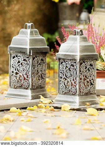 Engraved Lanterns On Tombstone. Old Town Graveyard In Forest Park. 24th Of October 2020. Hronov, Cze