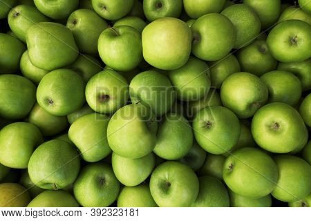 Green Apples Background. Beautiful Green Apples At The Market.