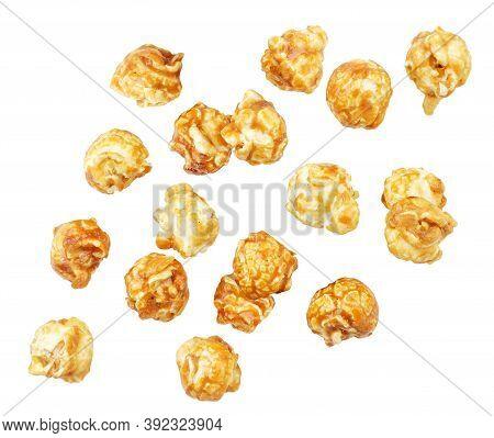 Popcorn Caramel Drops On A White Background, Popcorn Levitating. Isolated