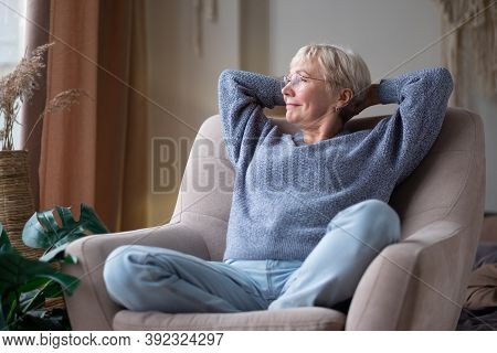 Older Caucasian Woman Resting Seated On Coach, Enjoy Summer Day