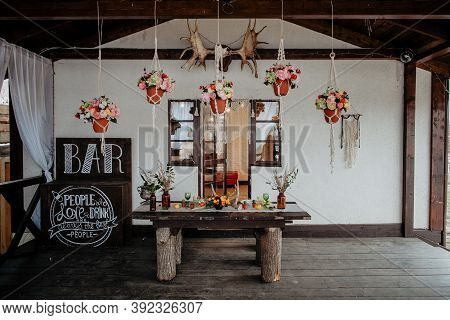 Boho Style In Wedding Decoration, Table Decorated In Rustic Style, Rustic House, Flowers Horns Table