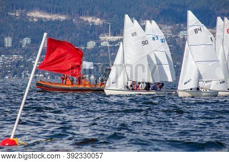 Fj Sailboats Line Up On The Start Line Of A Collegiate Sailing Regatta In English Bay, Vancouver, Br
