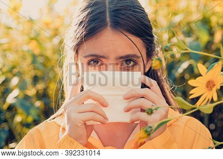 Young Woman Is Going To Sneeze. The Girl Suffers From Pollen Allergy During Flowering And Uses Napki
