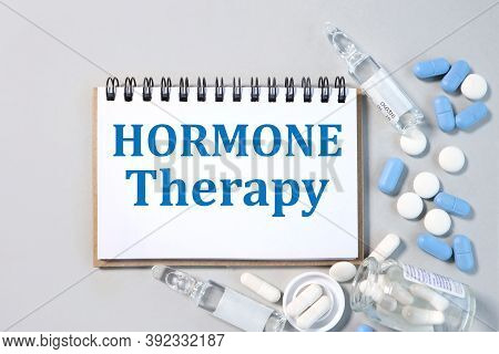 Hormone Therapy, Text On White Paper On Notepad On Gray Background