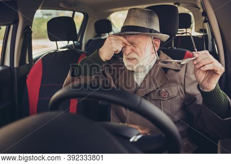 Portrait Of His He Nice Exhausted Tired Sad Depressed Grey-haired Man Driving Car In Traffic Jam Tou