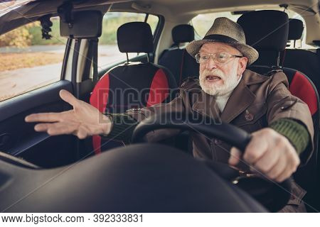 Portrait Of His He Nice Experienced Mad Annoyed Fury Furious Grey-haired Man Driving Car In Traffic