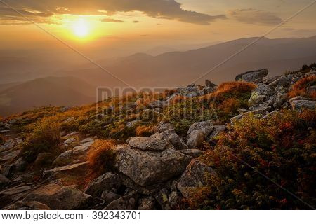 Beautiful View Of Mountain Landscape On Sunset With Rocks On Foreground In Autumn Carpathian Mountai
