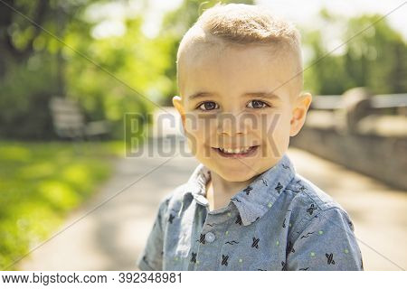 Happy Boy Child Enjoying Time At The Park