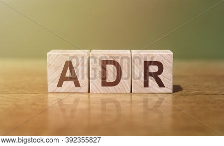 Adr Abbreviation For Adverse Drug Reaction Word Written On Wooden Blocks On A Wooden Table. Medical