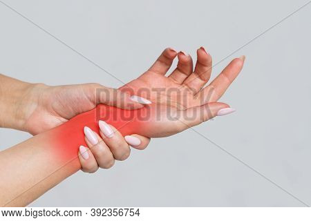 Female Arms Holding Her Painful Wrist Caused By Prolonged Work On The Computer, Laptop, Coloured In