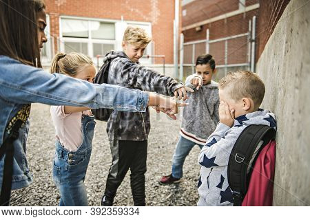 Sad Intimidation Moment Elementary Age Bullying In Schoolyard