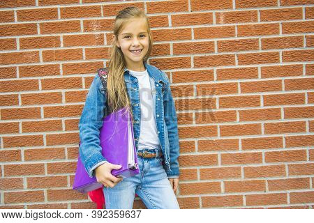 Beautiful Student Teenager Schoolchild With Backpack Looking At Camera
