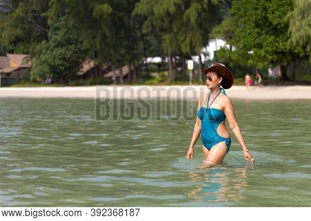 Woman In Blue Swimsuit Enjoy On Sea Water At Beach Koh Chang Thailand. Koh Chang Is Located In The E