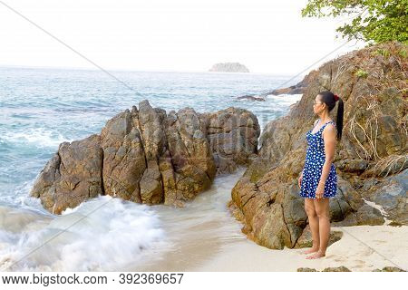 Woman Stand Look Wave In Morning On Lonely Beach At Beach Koh Chang Thailand. Koh Chang Is Located I
