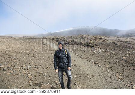 A Hiking Man From Mauna Kea Summit On The Big Island Of Hawaii