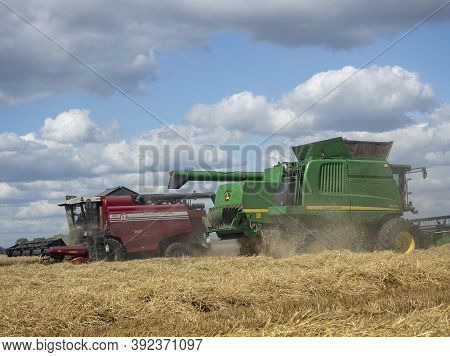 07.26.020 Russia, Bryansk Region. Two Agricultural Harvesters Are Harvesting. Agricultural Machinery