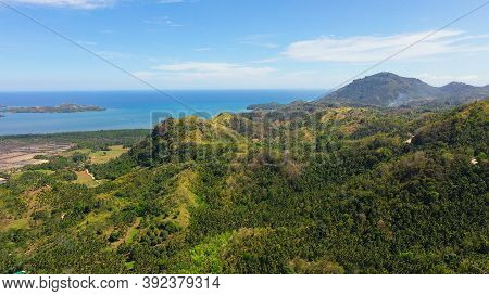 The Mountains And Hills With Tropical Forest With Blue Sea. Tropical Landscape, Mindanao, Philippine