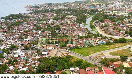 Aerial Drone Of City Of Iligan Near The Sea On The Island Of Mindanao, Philippines. Iligan City, Lan