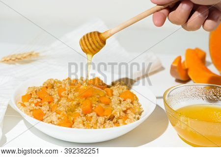 Homemade Oatmeal Porridge With Seasonal Autumn Pumpkin In A White Plate On A Light Background. Autum