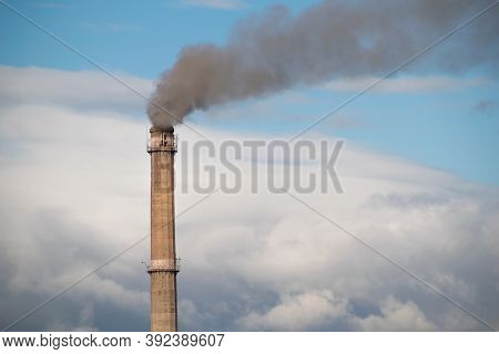 Industrial Smoke Stack Of Coal Power Plant. Steam From Smoke Stacks At A Power Substation