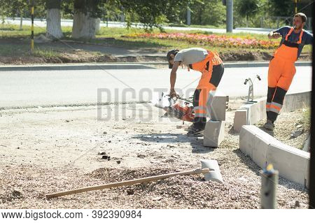 Moscow, Russia - 1 September 2020: State Municipal Workers In Orange Uniforms Doing Street Repair Wo