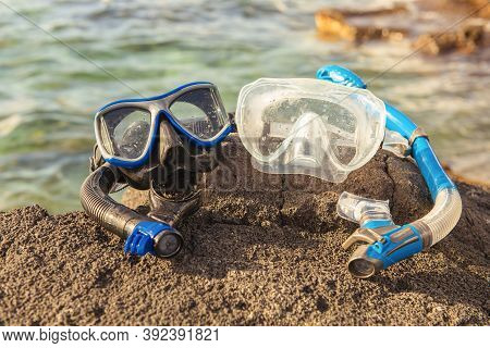 A Colorful Snorkle Or Diving Mask Located On The Rocks