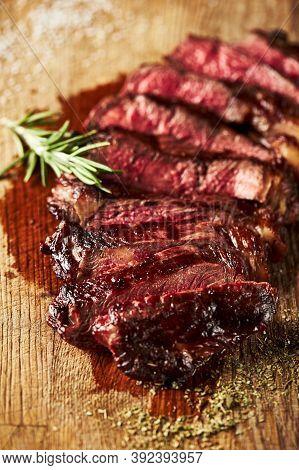 Close Up Of Sliced Grilled Medium Rare Ribeye Steak With Salt Cristals