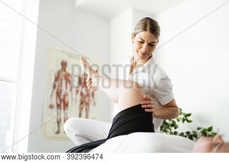 A Modern Rehabilitation Physiotherapy Woman Worker With Client