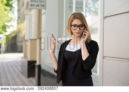 Portrait Of Beautiful Angry Looking Corporate Employee Woman Raising Hand In Air Frustrated Talking