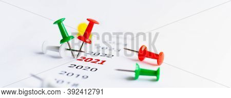 Year 2021 With Red Push Pins Written On Paper. Concept For Business Vision And Business Strategy. Su