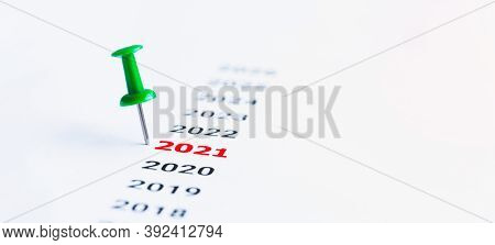 Year 2021 With Blue Push Pins Written On Paper. Concept For Business Vision And Business Strategy. S
