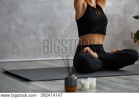 Portrait Of Sporty Young Woman Doing Exercises On Yoga Lesson At Home. Beautiful Girl Practicing Lot