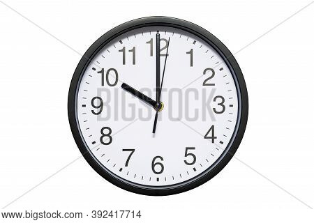 Wall Clock Shows Time 10 O'clock On White Isolated Background. Round Wall Clock - Front View. Twenty