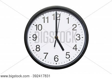 Wall Clock Shows Time 5 O'clock On White Isolated Background. Round Wall Clock - Front View. Sevente