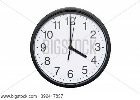 Wall Clock Shows Time 4 O'clock On White Isolated Background. Round Wall Clock - Front View. Sixteen