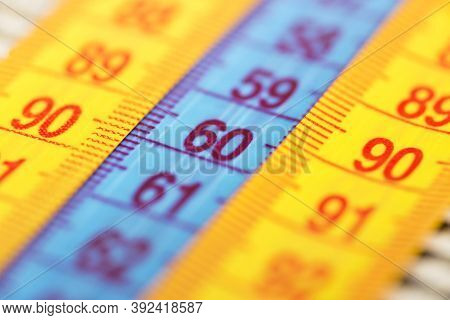 Three Measuring Tapes Showing 90-60-90 As Ideal Parameters For Women. The Concept Of An Ideal Figure