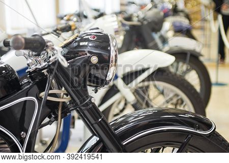 Row Of Many Motorcycle For Sale. Motorcycles Standing In The Row At A Store, Closeup. Motobikes In A