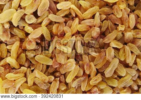 Raisins Are Beautifully Decomposed, Yellow Is The Highest Grade. Background Of Raisins In Sale In Th