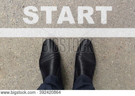 Black Shoes Of Businessman Standing At The Start Line To Start Or Begin New Life. Businessman Is Loo
