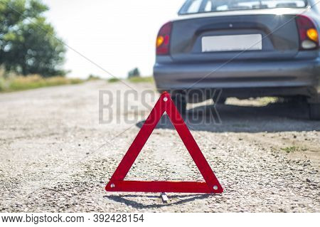 Broken Car Concept, Breakdown Triangle On Road. Sign Of Emergency Stop Car On The Road. Broken Down