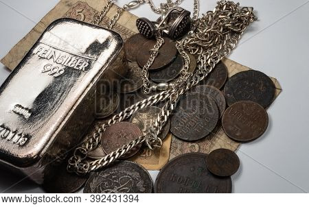 The Old Copper And Silver Coins, Silver Bullion And Jewelry Lay On A Old Bills. Feinsilber Is Fine S