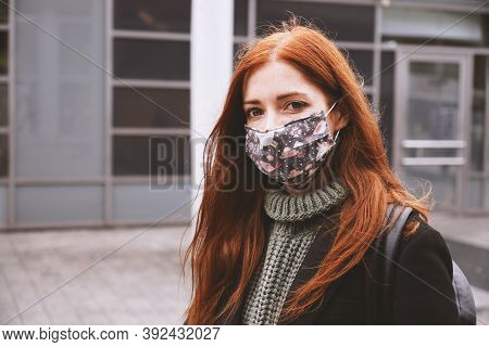 Young Woman Wearing Self-made Everyday Cloth Face Mask Outdoors In City - New Normal Covid-19 Corona