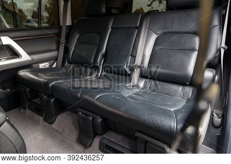Rear Seats Of The Car For Three Passengers In The Back Of An Suv Covered In Black Leather With The A