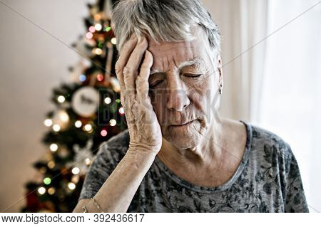 A Close-up Of Sad Senior Womans Face On The Christmas Day