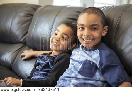 Cute Happy African American Sit On The Livingroom At Home