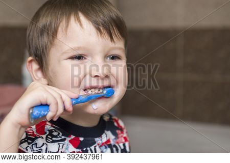Kid Boy Brushing Teeth. Little Baby Boy With Tooth Brush