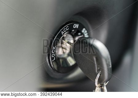 Close Up Of Car Key In Keyhole For Ignition. Car Keys In Ignition About To Start The Car. Macro Of M